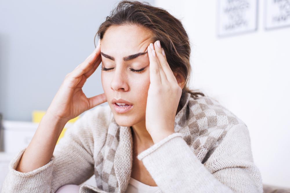 woman with headache migraine